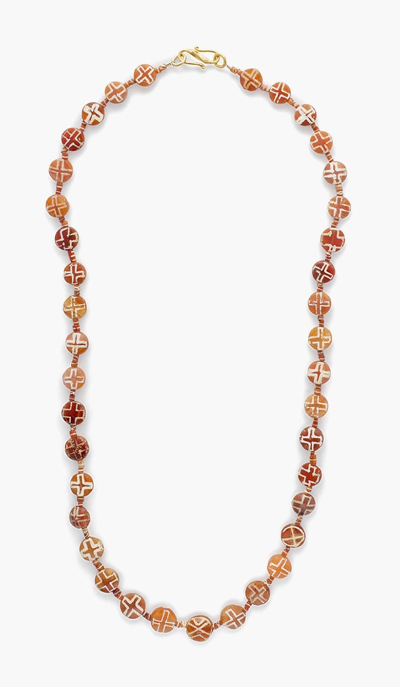 A Western Asiatic etched carnelian bead necklace . Circa late 3rd-early 2nd millennium B.C. 22⅝ in (57.5 cm) long. Estimate: $1,500-2,000. This lot is offered in  Ancient Jewelry: Wearable Art , 29 November–8 December 2016, Online