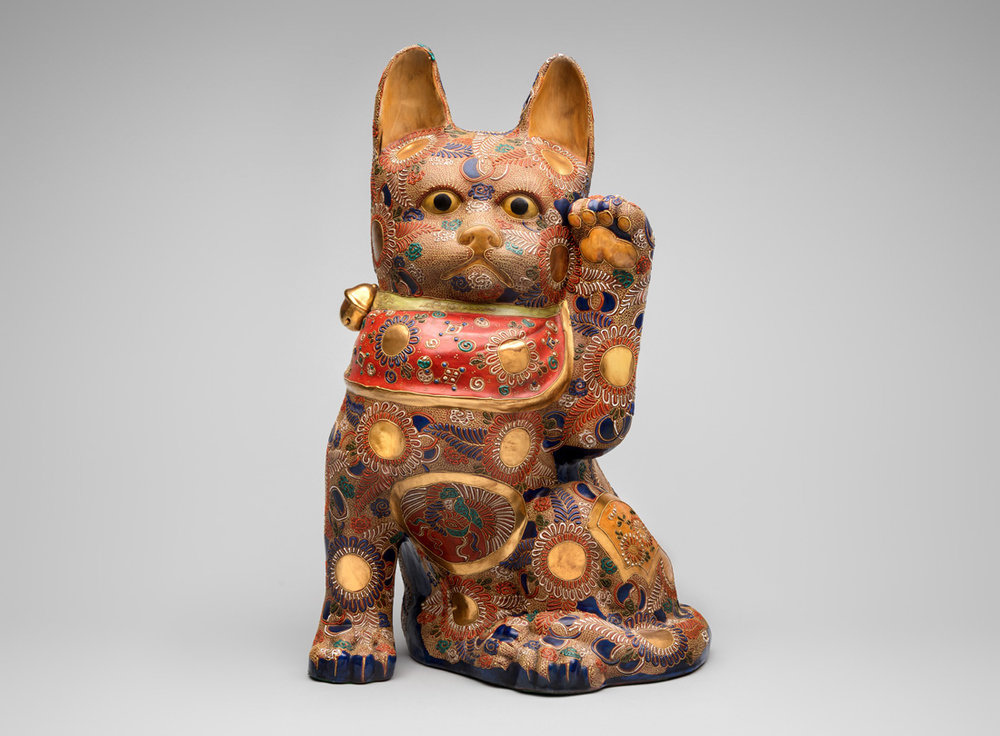 Kutani kilns, Japan. Maneki neko 20th century, porcelain. Gift of Billie L. Moffitt, Mingei International Museum 2010-04-117 L2017.3201.096