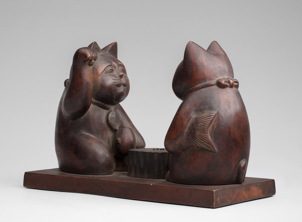 Maneki neko pair imitating the gods Daikoku and Ebisu playing Go 20th century, Japan. Wood. Gift of Billie L. Moffitt. Mingei International Museum 2010-04-145 L2017.3201.084