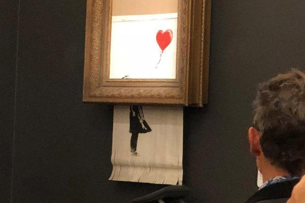 Banksy's  Girl with a Balloon  appeared to shred itself after selling for $1.4 million at Sotheby's on Friday night. Courtesy of Sotheby's.
