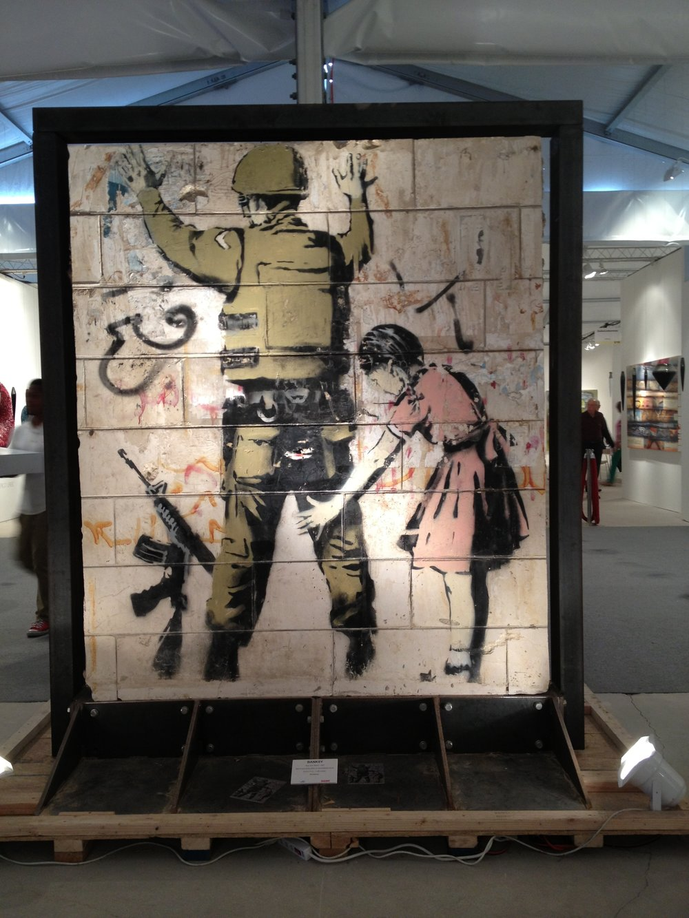 Banksy stenciled painting on wall section removed from Gaza Strip offered for sale at Art Basel|Miami. Photo ©Micaela van Zwoll.