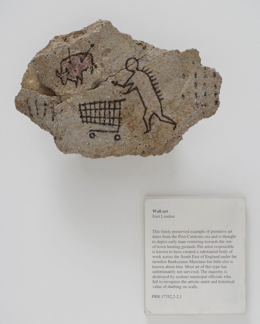 Banksy,  Peckham Rock  (2005). The piece was secretly installed at the British Museum in 2005 and went undetected for days. Photo courtesy of Banksy and Pest Control.