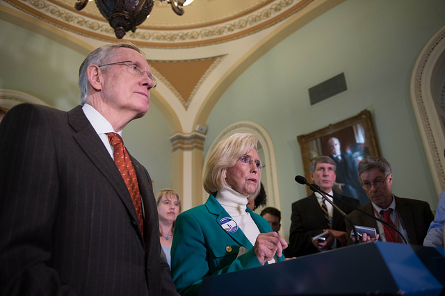 Lilly Ledbetter at a press conference with Senate Majority Leader Harry Reid at the Fifth Anniversary of the Signing of The Lilly Ledbetter Fair Pay Act.