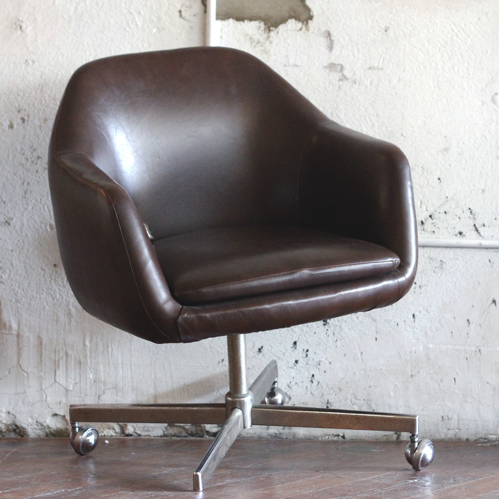 "Brown faux leather chair with disability in office on job interview; not giving up dream of one day holding up human like a ""normal"" chair. #SidLeeStock"