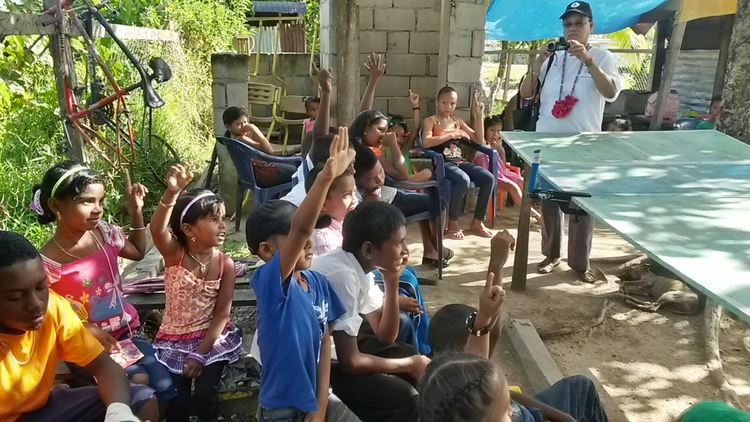 Children of Meten-Meer-Zorg participating in an activity led by a Guyana Foundation volunteer.