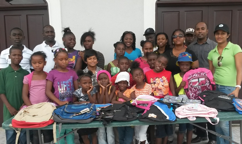 Guyana Foundation team with some of the recipients of the backpacks.