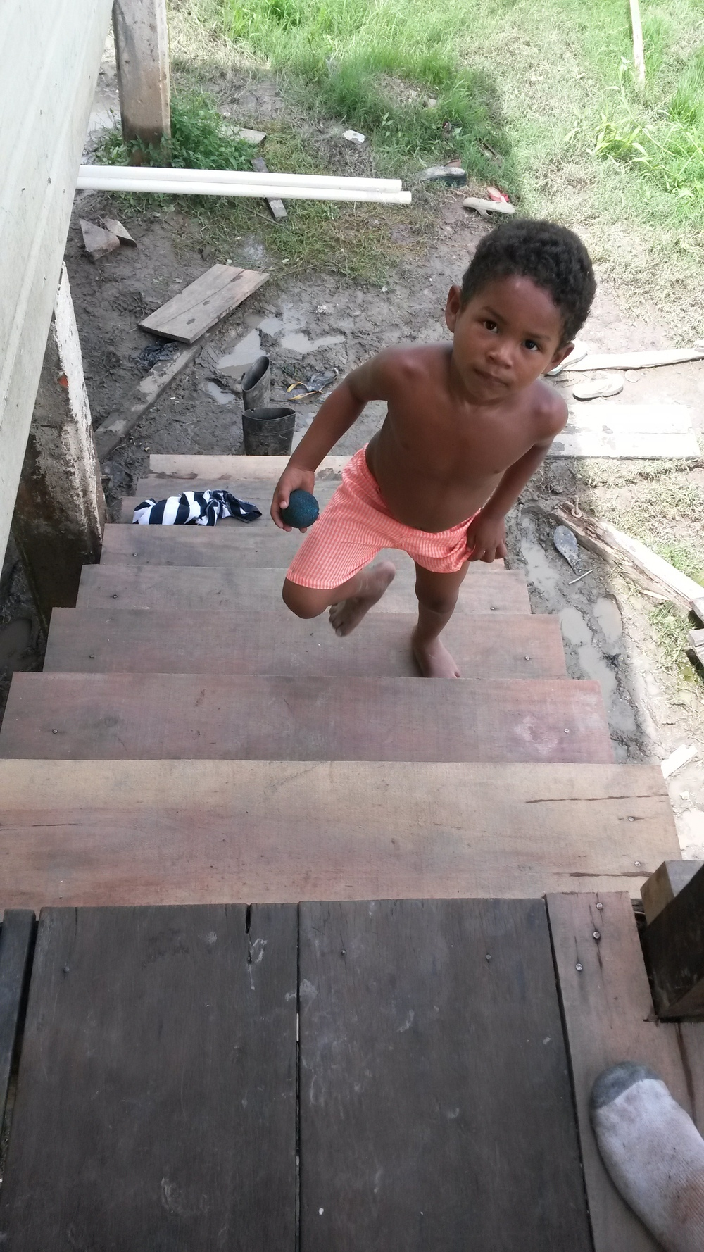One of the children walking up the newly built front stairway. Rails will be installed shortly.