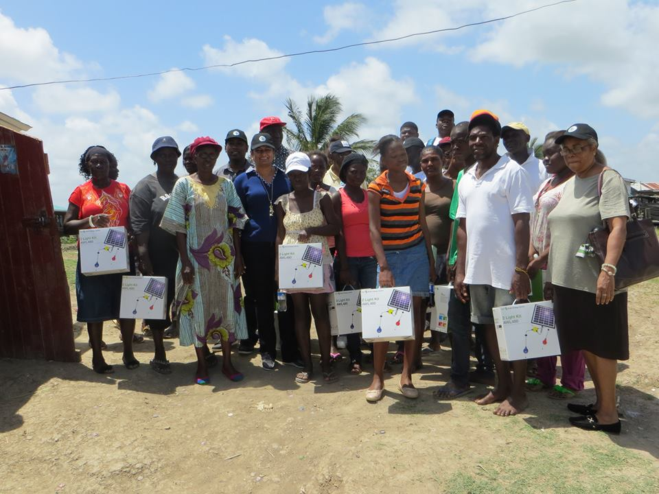 Recipients of solar light kits with a team from the Guyana Foundation in Breezy Point.