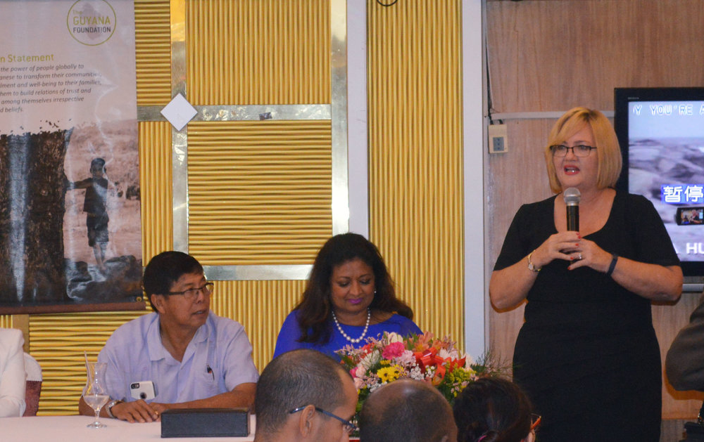 Ms. Susan Isaacs gaving brief remarks after being introduced as the new Managing Director of the Guyana Foundation. Sitting to her right is Mrs. Supriya Singh-Bodden, Founder of the Guyana Foundation and Mr. Stanley Ming, Trustee of the Guyana Foundation.