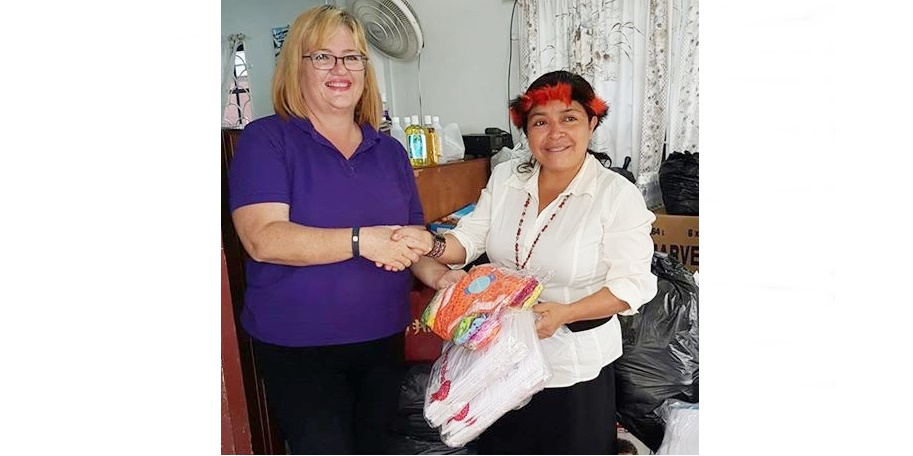 Managing Director Susan Isaacs handing over items from our clothing drive to APA representative, Laura George, 31st May 2017.