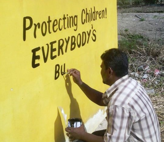 Painting the walls in this school in an effort to protect children from sexual abuse.