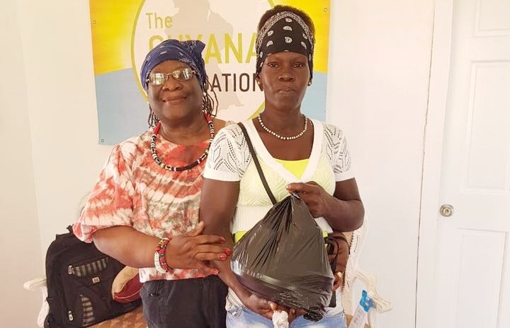 Ms. Francis Yvonne Jackson and Monique whom the Guyana Foundations along with Food for the Poor assisted tremendously in the buildng of her new home.