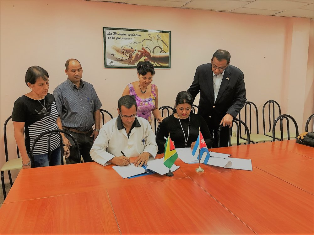 Signing of the MOU between the Rector of the University, Angel Batista Diaz and Supriya Singh Bodden of the Guyana Foundation.