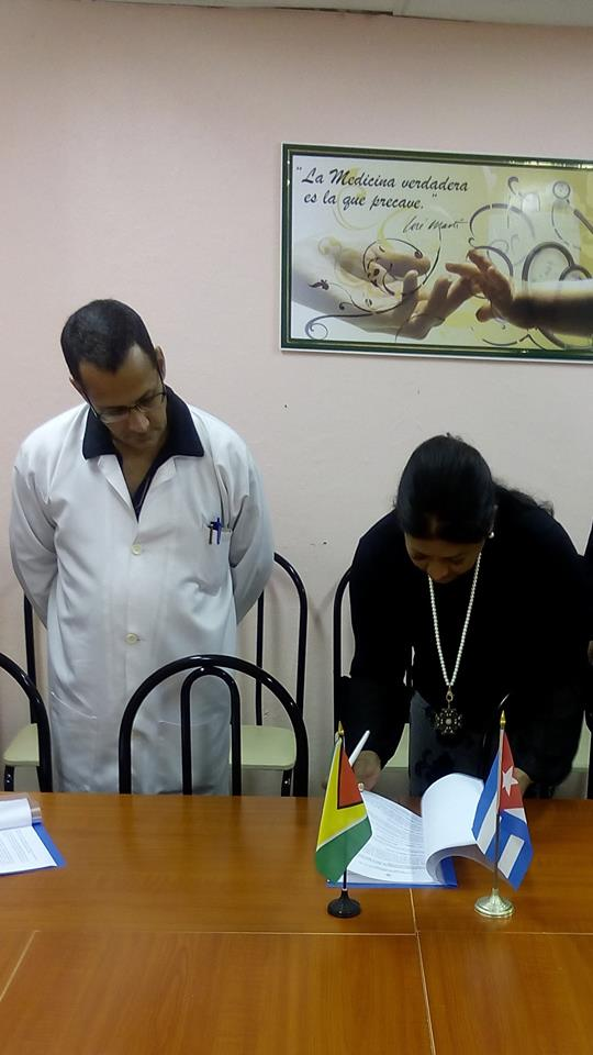 Ms. Supriya Singh-Bodden is seen here with Dr. Angel Batista Diaz formally signing a Memorandum of Understanding between the Guyana Foundation and the University of Medical Sciences of Ciego de Avila.