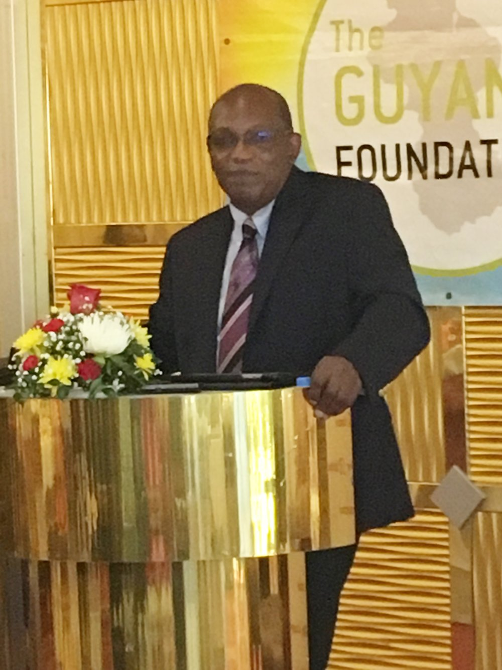 Mr. Eric Phillips, Trustee of the Guyana Foundation delivering brief remarks.