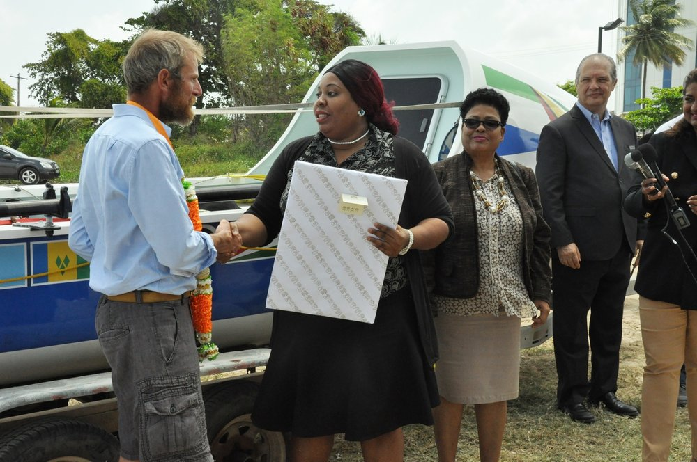 Mrs. Geneva Ross-Tyndall of the Ministry of Foreign Affairs presenting Richard with a gift.
