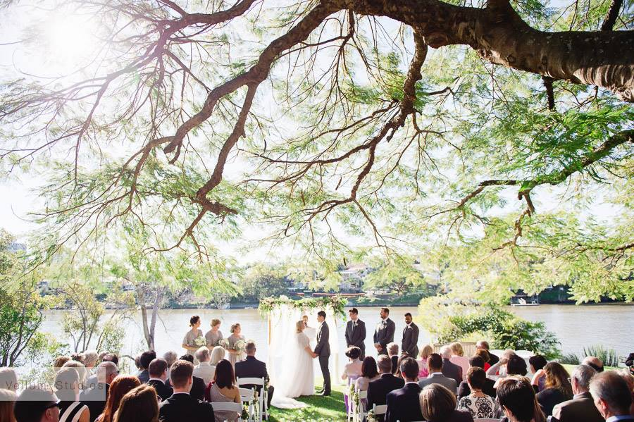 "If someone asks me where to go for drinks on a Friday, I automatically say ""somewhere on the river!"" I think this is where the love of riverfront weddings comes from. Emma and Nick said i-do at Toowong Rowing Club as guests soaked up the sun and inhaled the cool river breeze. Photo via Vellum Studios."