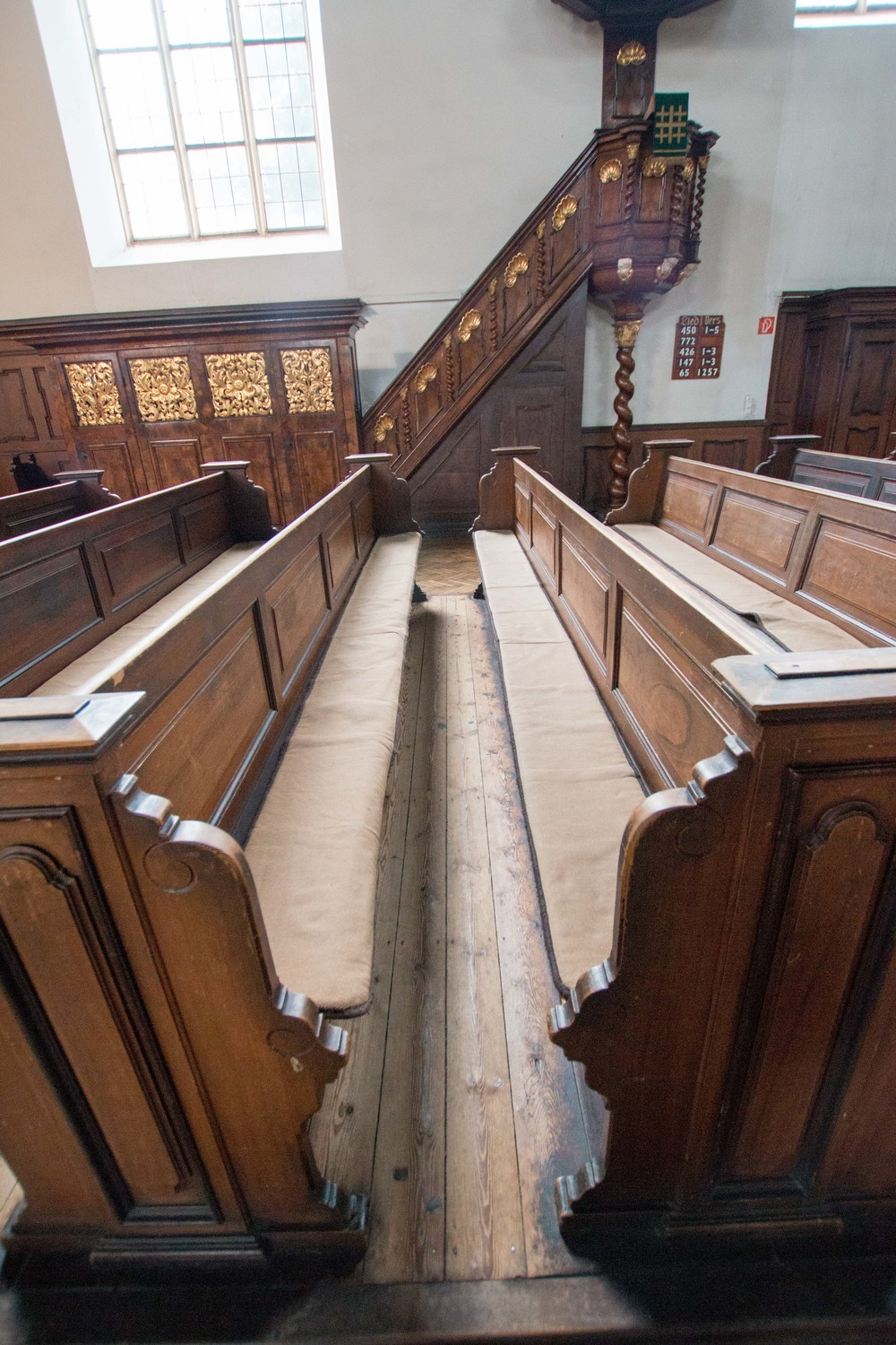 The double benches with the pulpit in the background