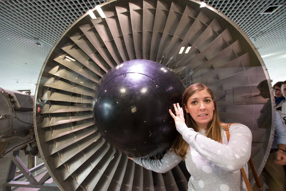 Meghan holding up a plane engine