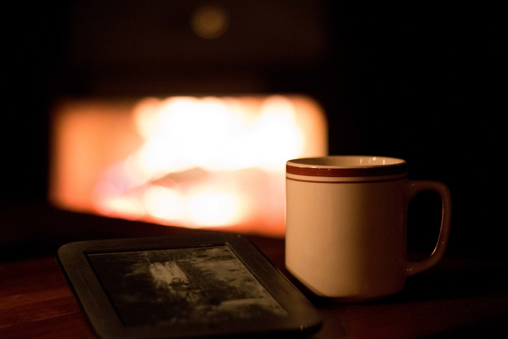 Relaxing with a hot cup of tea and reading my Nook bycandlelight next to the fire. #relaxing