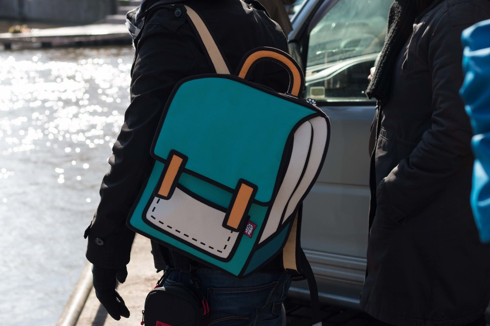 Yes, that's a real backpack, not photoshopped in.
