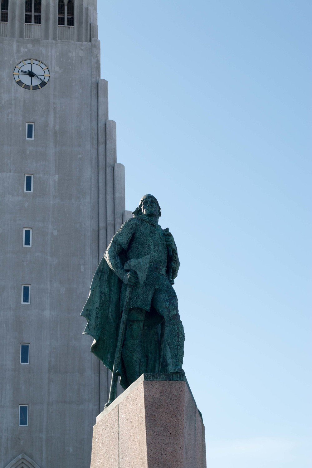 Statue of Lief Erikson outside Hallgrimskirkja with the church tower in the background