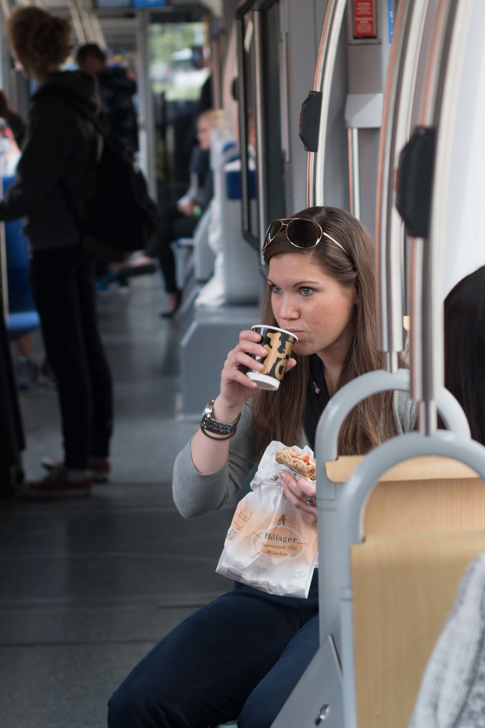 Kate enjoying a coffee on the tram