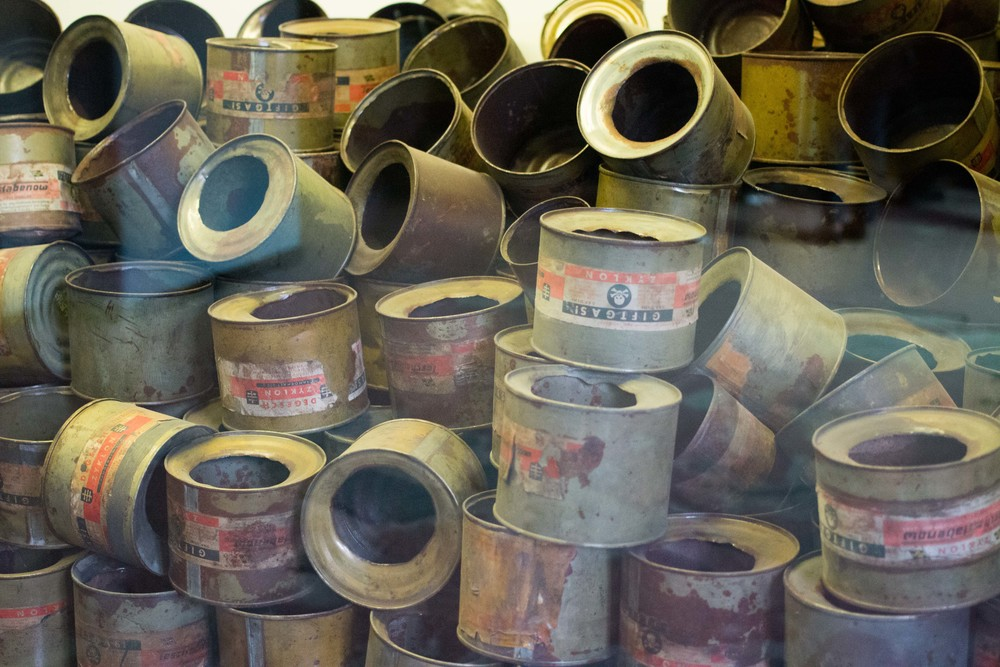 stacks of empty Zyklon B canisters - the poison used to gas the victims