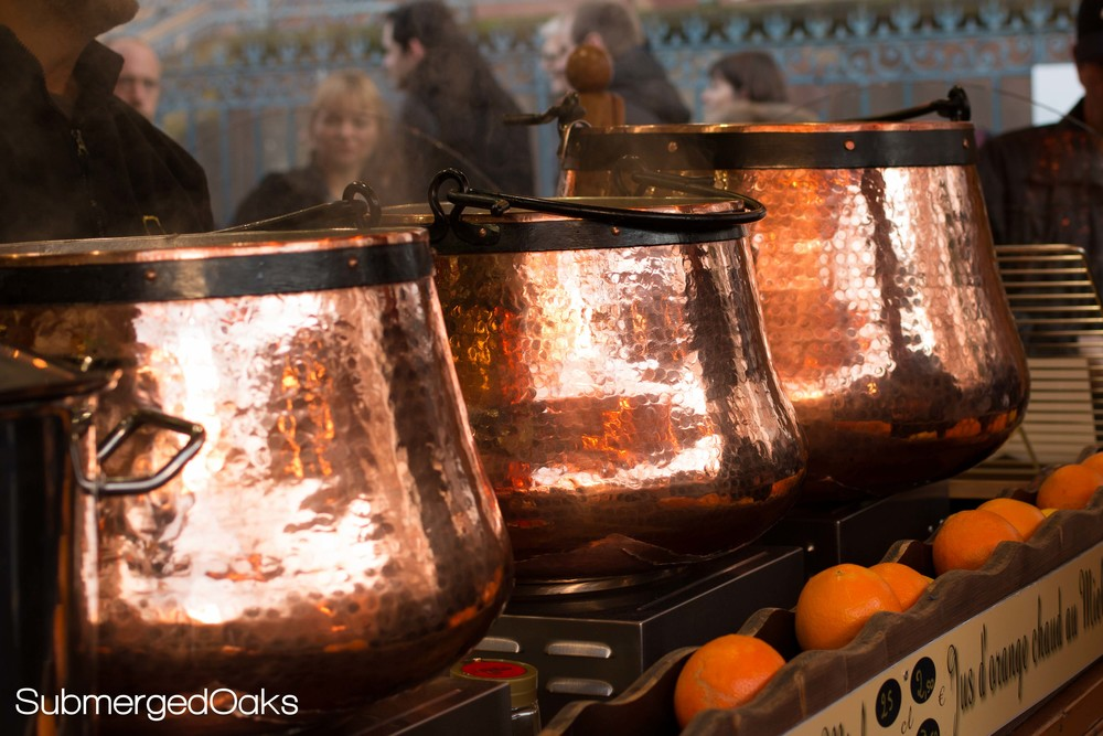 Bright copper kettles filled with steaming glühwein
