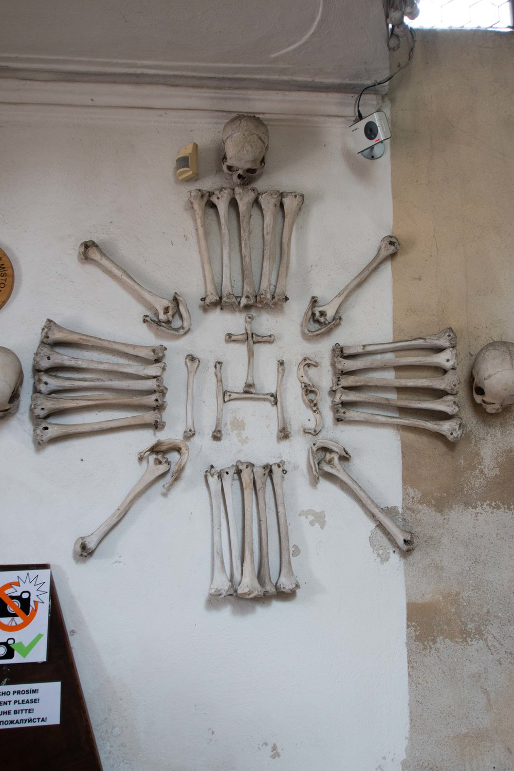 Human bones adorn even the walls while a security camera keeps an eye on visitors
