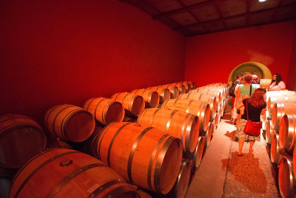 Chianti aging in oak casks in the cellar of the Ruffino winery