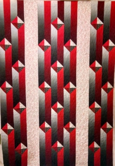 Ombre red and gray, made by Melissa E.,  quilted by RM 2017
