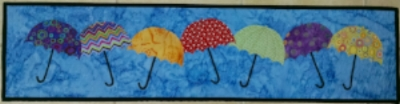 Quilt Art- Dancing Umbrellas, original design, made and quilted                 by RM, 2015