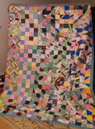 Top made of feedsacks, property of Ginny C, quilted by RM 2017.