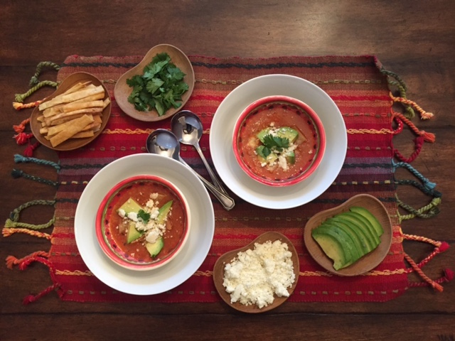 Tortilla soup and its yummy friends to garnish!