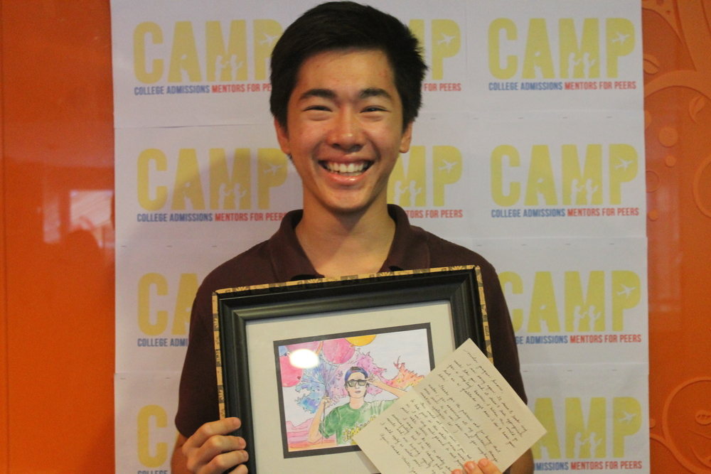 CAMP Mentor Joaquin Benares (Wesleyan '15) receives a gift from 2013 mentee Mawi Albert.