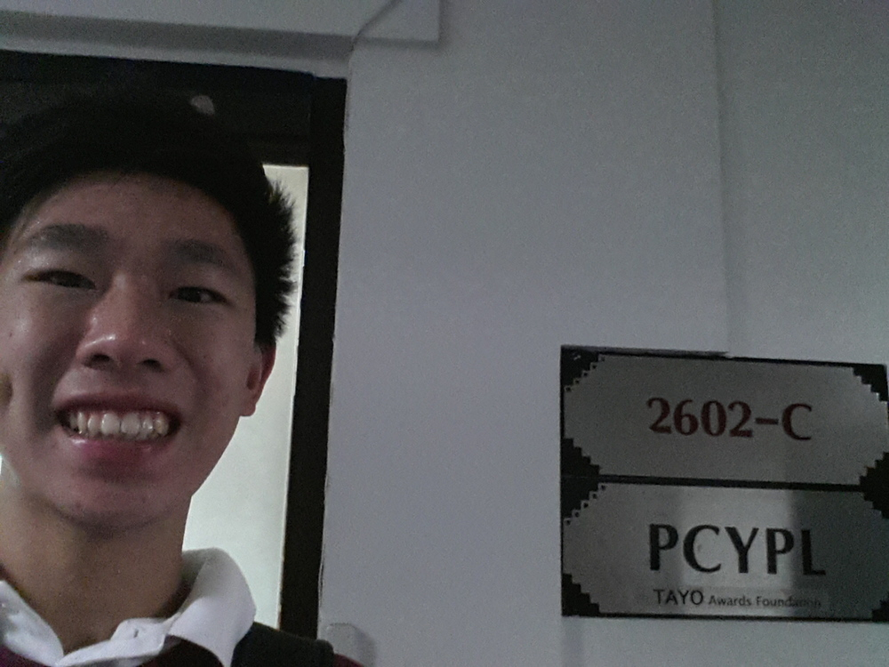 TAYO Foundation intern Alexander Go Tian poses outside his office.