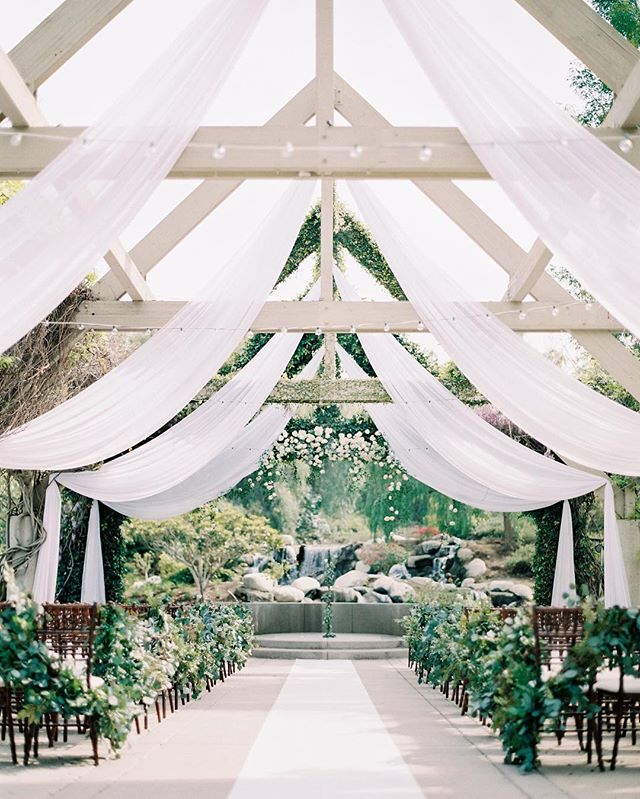 The monochromatic palette & beautiful textures of the silk draping helped make Soozie & Aaron's ceremony site an absolute dream. Love the organic, lush feel of it all 🌿 ⠀⠀⠀⠀⠀⠀⠀⠀⠀ #villamontalvo #bernarduslodge #bernarduswinery #nestledown #hammerskyvineyards #mitchellsmeadows #beaulieugarden #slideranch #cielofarms  #sanysidroranch #sanysidroranchwedding #maliburockyoakswedding #holmanranch #santaynezweddingphotographer  #firestonewinery #palmspringsweddingphotographer #losangelesweddingphotographer  #calaviewedding  #ojaiweddingphotographer  #santaynezwedding  #santabarbaraweddingphotographer #orangecountyweddingphotographer #korakia #parkerpalmsprings #parkerpalmspringswedding #colony29 #belairbayclub #belairbayclubwedding #carmelweddingphotographer #holmanranchwedding