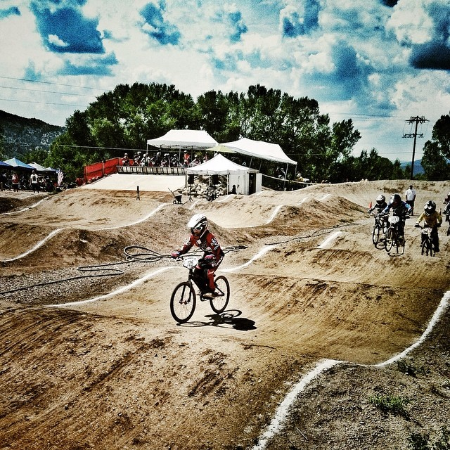 Watched BMX racing today for the first time. Super fun! Here is my 10 yr. old neighbor gunning for 1st.