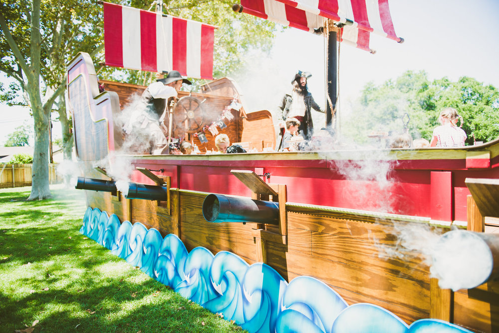 Our cannons really work!  The kids get to pull on a rope in the back of the cannons which fires smoke, makes a big cannon blast and the barrel lights up red from the inside!  Photo By Natasha Sadikin