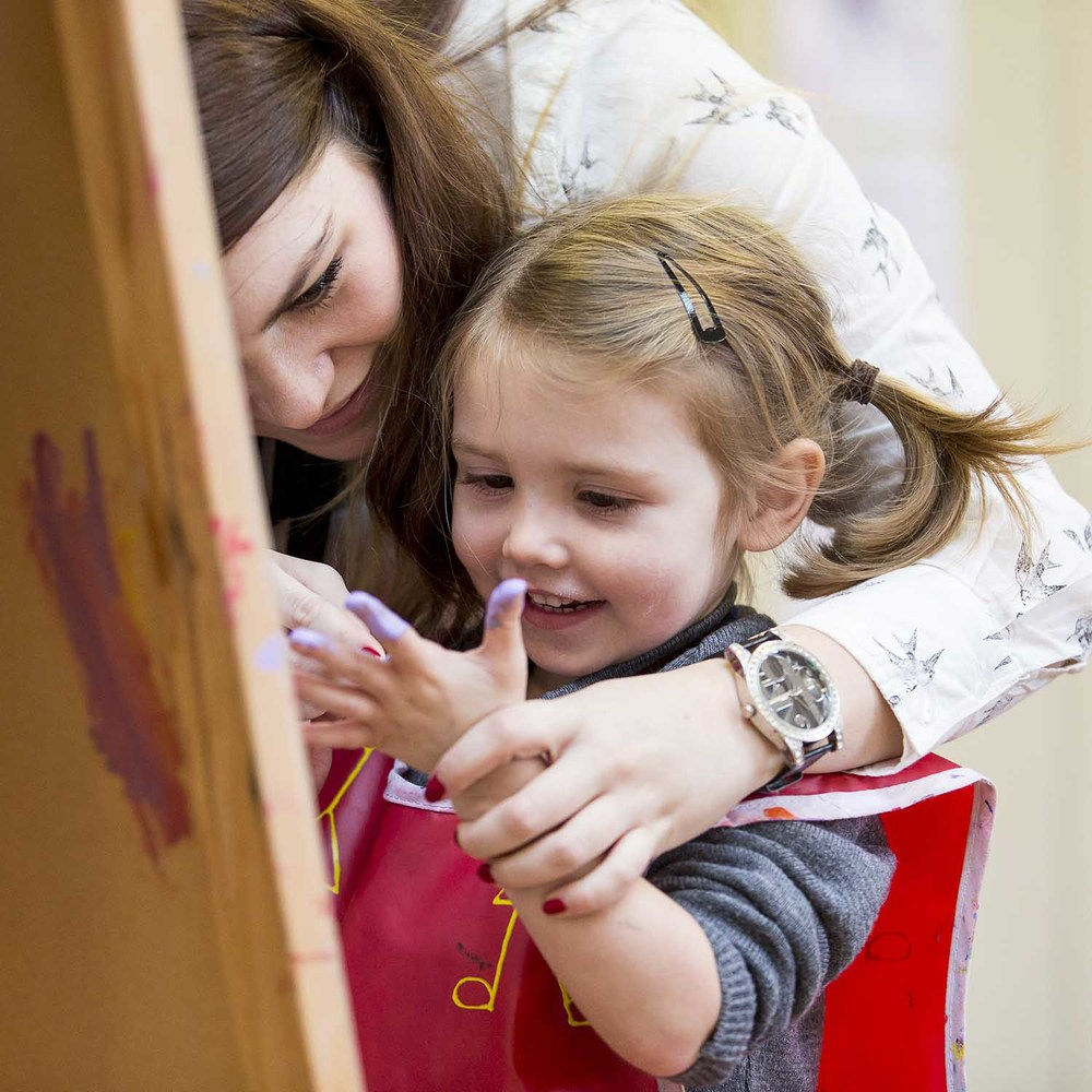 Girl Painting with Teacher
