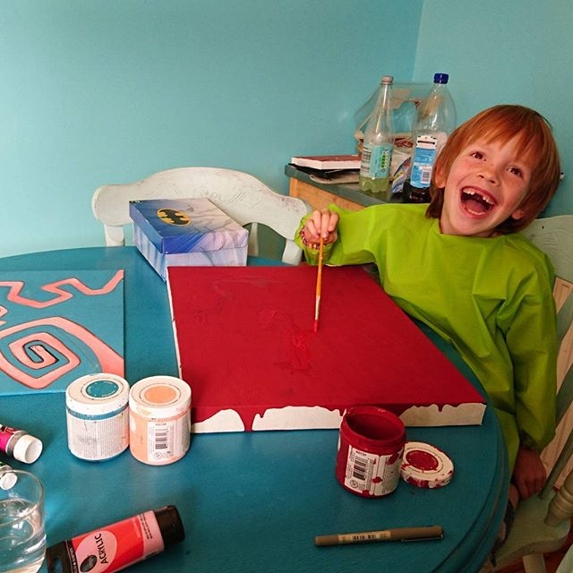 James has lost a couple of teeth but retained his passion for Art! He's been working on his backgrounds and loves the way it looks like blood oozing down the side of his canvas.  #kidartist #youngartists #Ingingerness #redhead #gingerhair #gingerpride #Art #Creativekids