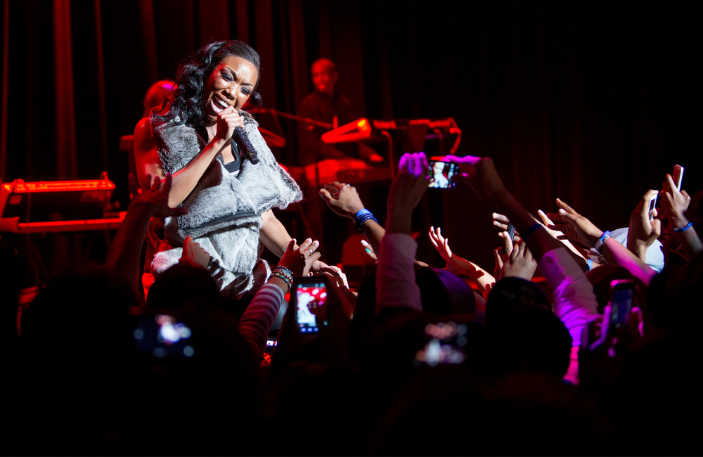 Brandy performing one of her classic hits. There are at least 8-9 cell phones visible in this one photo.