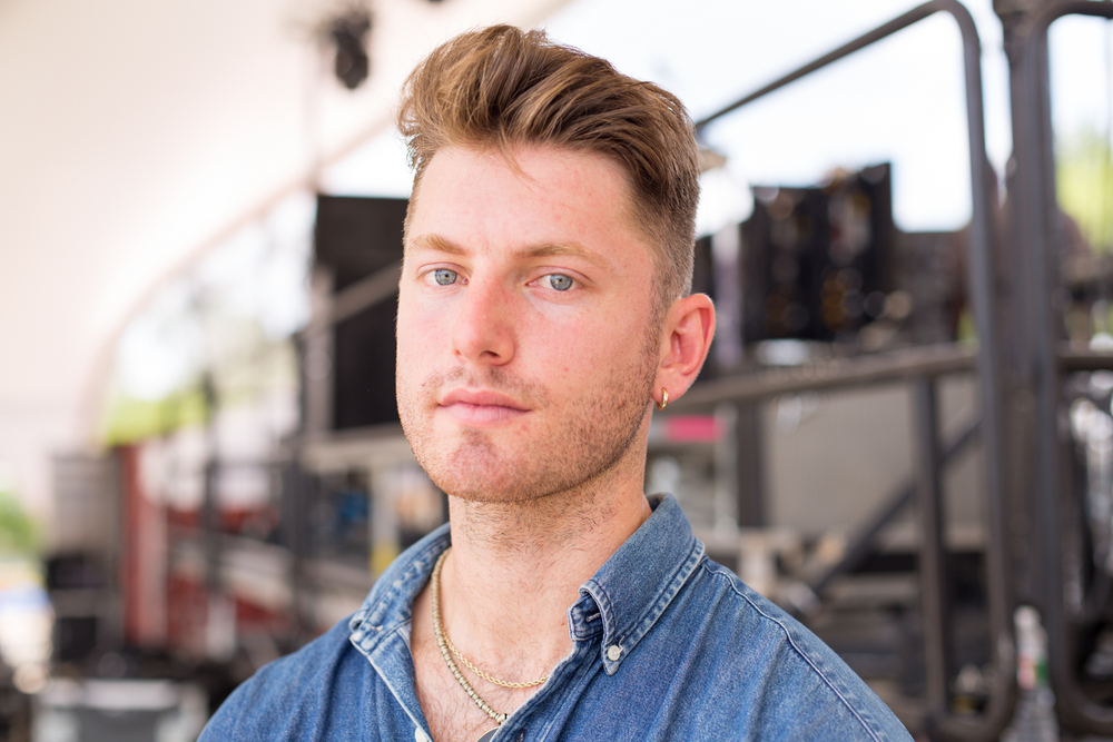 Marc E. Bassy, backstage following  his performance on the smaller stage.