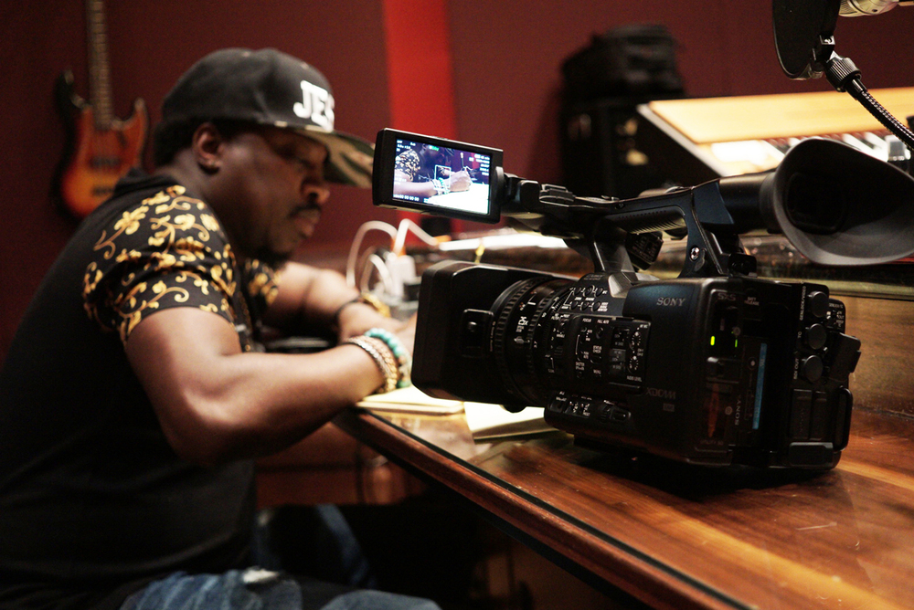 The Sony x180, photo bombed by Anthony Hamilton, writing to a beat.