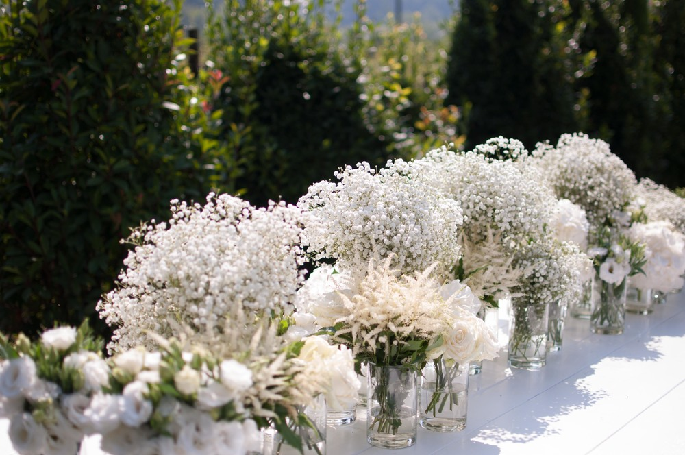 Babies breath, Avalanche roses, Lysianthus, hydrangeas and Astilbe. An all white wedding.