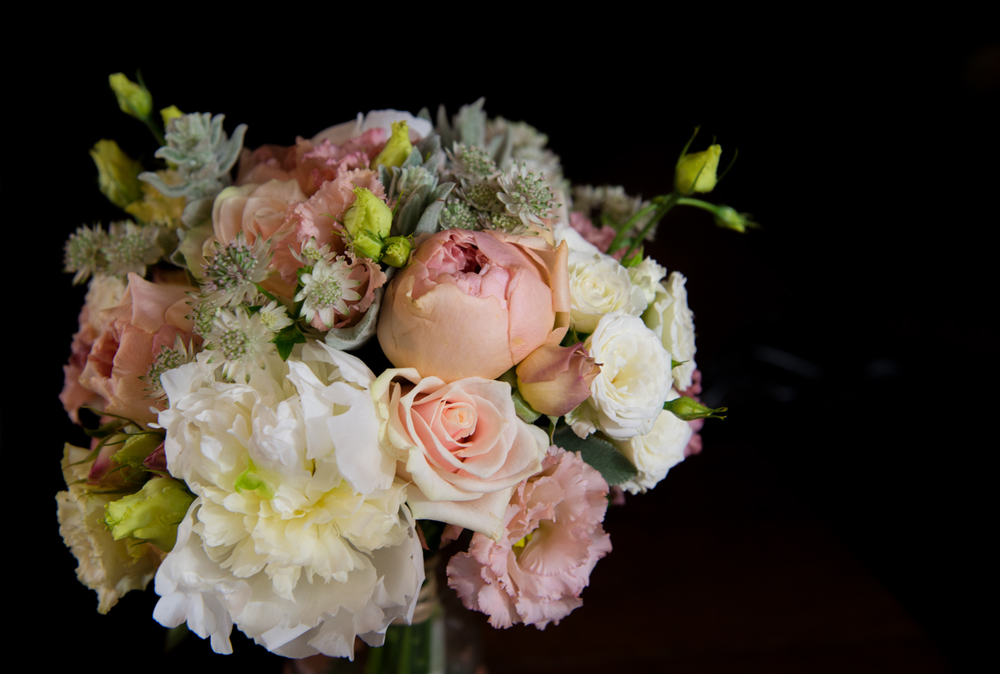 Bridal bouquet with garden roses, peonies and lysianthus.