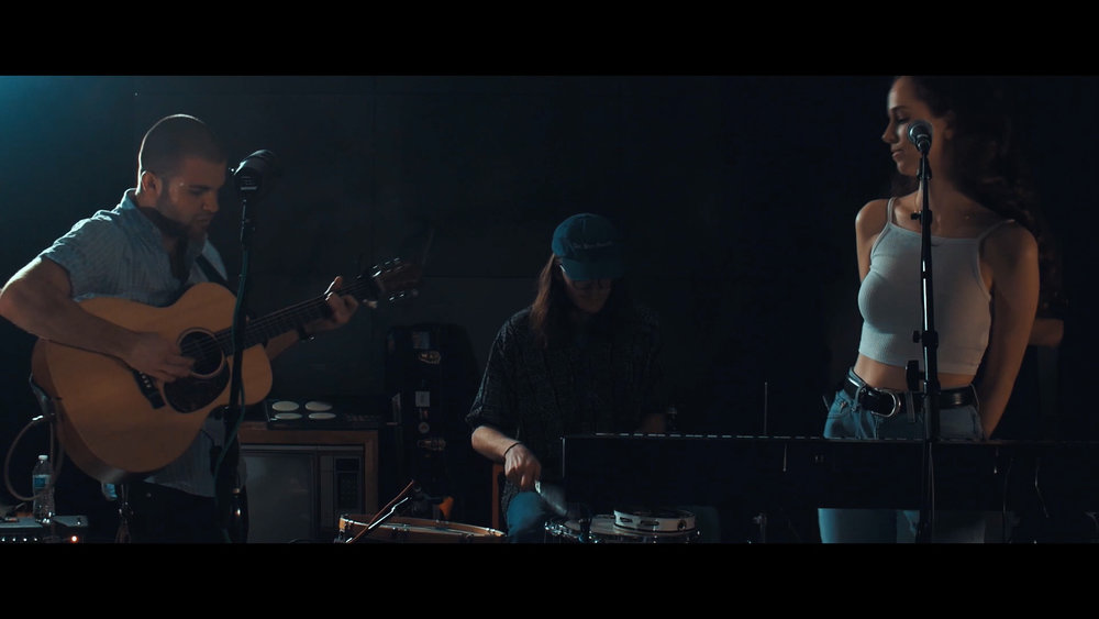 Pictured above, L to R: Nick Johnston (vocals, guitar), John Lewandowski (drums), Katy Carmichael (keys, BGVs)