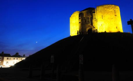 """The Tower will be lit up bright for one of York's oldest and most historic sights. So bright, in fact, that it's turned yellow.The 13th century tower is its walls bright yellow in honour of the biggest event to hit York this year.  As the Tour De France's peloton wheels into town, the tower's will be illuminated yellow in honour of the iconic """"maillot jaune"""", or yellow jersey, worn by the leading rider each day of the Tour.  Clifford's Tower will be passed by the Tour De France riders on the second day of the Tour's journey through Yorkshire, with the winner of the previous day's sprint finish on Harrogate's Stray sporting the yellow jersey.  It will continue to be illuminated yellow every day of the one hundred Day Cultural Festival, in the run up to the Grand Depart 2014. It will glow yellow from 6pm-12am daily.  We spoke to shoppers in the town on April 6th, Percy Hanner of Escrick said """"This will be a lovely sight to see on an evening and will remind everyone what a special occasion it is for York and Yorkshire with the Tour De France being hosted in our region. I hope people appreciate it.""""  English Heritage's Julie Spowart, has stated that """"York is very proud to be showing support and celebration of Yorkshire's Grand Depart by literally turning Clifford's Tower yellow at night as part of the 100 day Cultural Festival in Yorkshire. As an iconic landmark in the city, it's great to see this beacon of yellow shining on the route that the cyclists will follow on their route.""""  We want you to tweet pictures of the Tower when lit up yellow to @SelbyEveryday"""