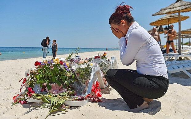 Devastated receptionist Amal Khouaja of the Imperial Marhaba hotel in Sousse, Tunis, laid flowers on the beach today. She spoke to reporters and stated that she will forever hold the thoughts of the holiday makers close to her heart.